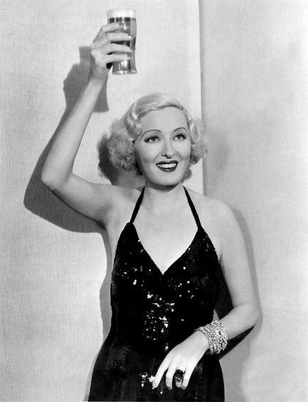 Peggy Hopkins Joyce, ex Ziegfeld Girl raises a glass to celebrate the end of prohibition.