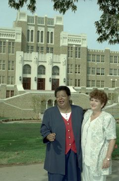 Elizabeth Eckford and Hazel Byran pose outside of Little Rock Central High, 1997