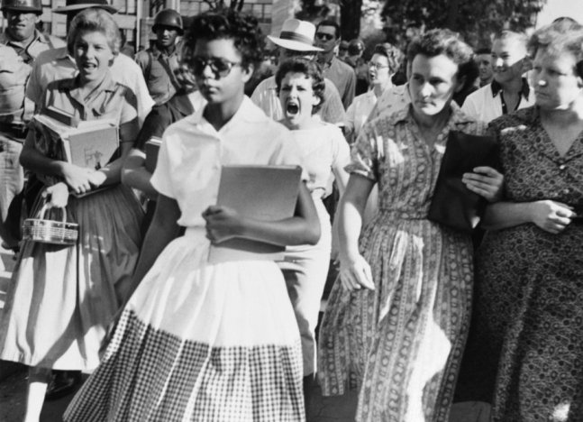 The infamous 1957 image of 15 yr old Elizabeth Eckford walking to Little Rock Central High School