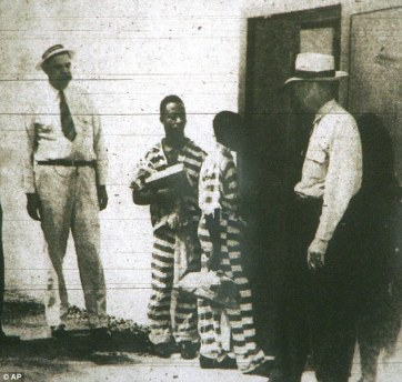 George Stinney, center right, enters the 'death house' in Columbia Penatuary