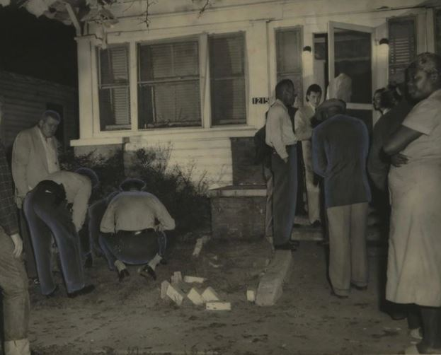 Police investigate a bomb blasted home in 1956, credit to Jeremy Gray